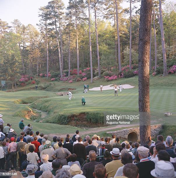 Action on the 13th green during the 1966 Masters Tournament at Augusta National Golf Club in April 1966 in Augusta Georgia