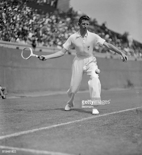 Action on the center court! Donald Budge, sensational coast star, is shown during a volley in the game in which he defeated John Van Ryn. The game...