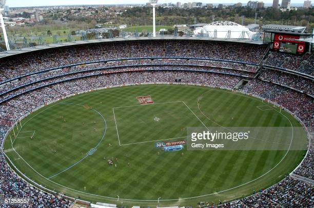 Action on the ground at the AFL Grand Final between the Port Adelaide Power and the Brisbane Lions at the Melbourne Cricket Ground September 25 2004...