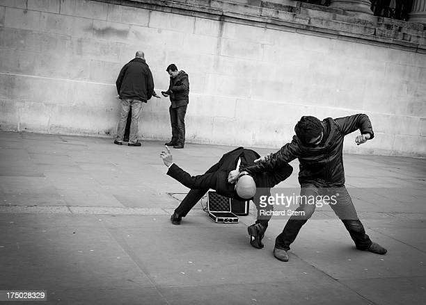 "Action performance street ""mock fight"" incident entertainment ""Black and White"" BW aggression balletic men moving movement balance ""Trafalgar Square""..."
