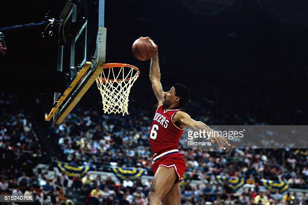 Action, Philadelphia 76ers' Julius Erving making a basket during unidentified game .