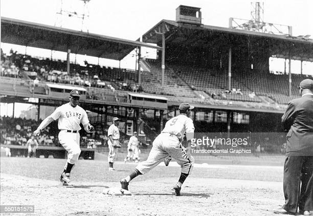 Action photographic print taken during a Negro League game between the home team Homestead Grays versus the New York Black Yankees at Griffith...