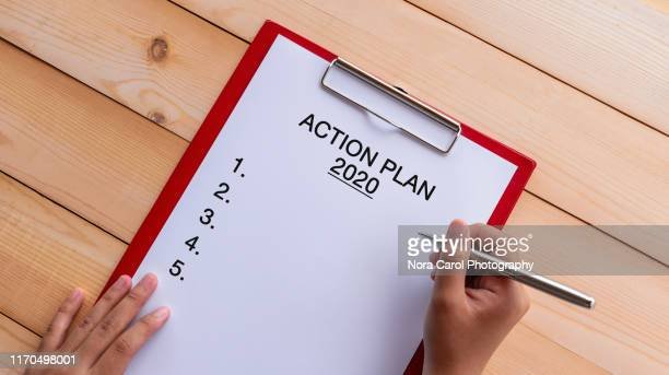 action plan 2020 text on clipboard - vision 2020 stock photos and pictures