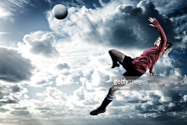 action portrait of ball kicked by female teenage soccer player - lust girl stock photos and pictures