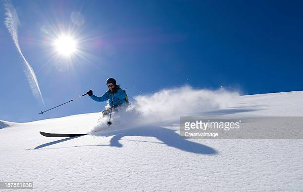action shot of an alpine skier - telemark stock pictures, royalty-free photos & images