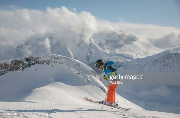 Action shot of teenager jumping with his skis, The Ski resort Ischgl Silvretta Arena, Austria