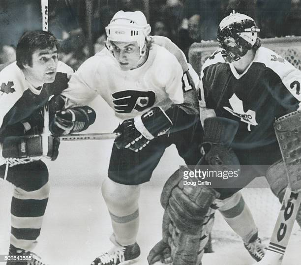 Action Spot Maple Leaf defenceman Tracy Pratt ties up Flyers Paul Holmgren as Mike Palmateer tries to clear traffic from in front of his goal last...