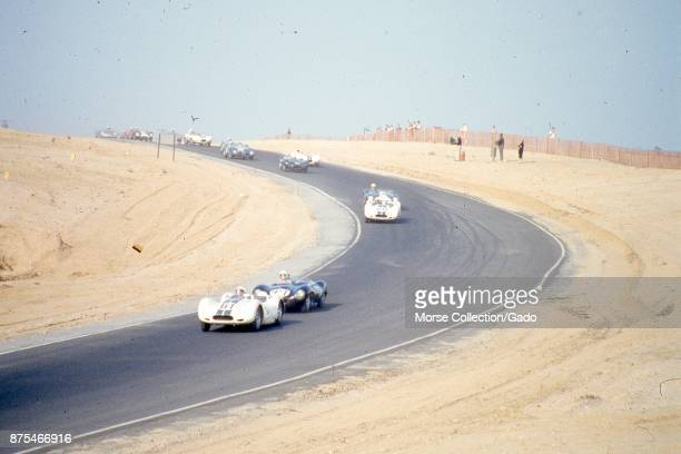 Action view of sports car driving at speed during the SCCA National Races in Bridgehampton, New York, August 17, 1958. In the lead car is Mr. Ed...