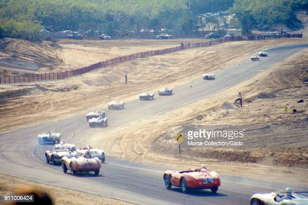 Action view of sports cars cruising along the track during the SCCA National Races in Bridgehampton New York May 31 1959 At bottom center in red is...