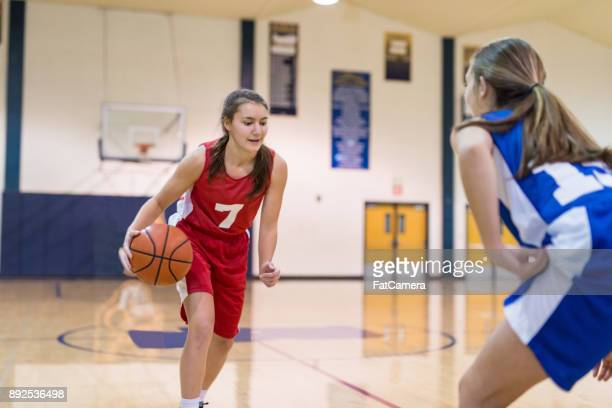 action-packed girl's high school basketball game - school girl shoes stock pictures, royalty-free photos & images
