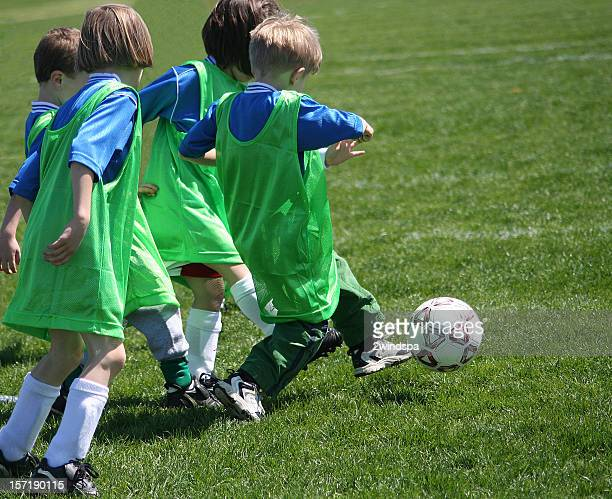 Active Boy is Soccer Team Kicker