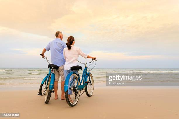 active couple with bikes - couples stock pictures, royalty-free photos & images