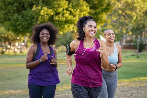Active curvy women jogging 1141393089
