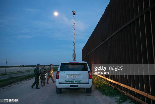 Active duty U.S. Army soldiers and a Border Patrol agent coordinate while manning a high-res surveillance camera at the U.S.-Mexico border fence at...