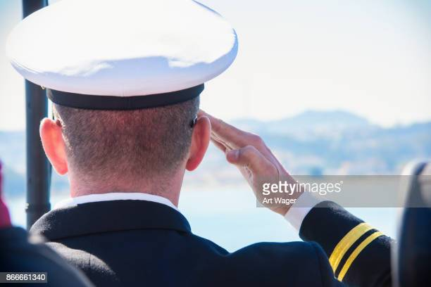 active duty u.s. naval officer saluting - navy stock pictures, royalty-free photos & images