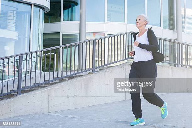 Active elderly woman jogging through Stuttgart