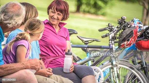 Active grandparents with grandchildren on cycle ride