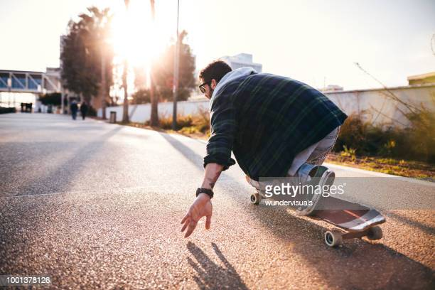 active hipster man skateboarding and having fun in the city - eurasia stock pictures, royalty-free photos & images