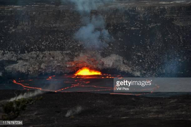 Active lava exploding inside the Halemaumau Crater at night. Kilauea Volcano. Volcanoes National Park. Big Island. Hawaii. USA.