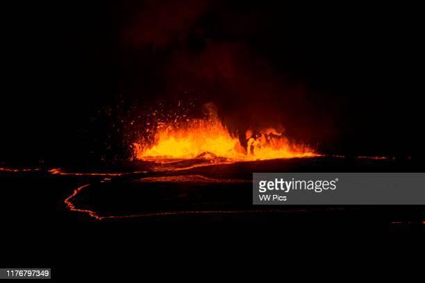 Active lava exploding inside the Halemaumau Crater at night. Kilauea Volcano. Volcanoes National Park. Hawaii. USA.