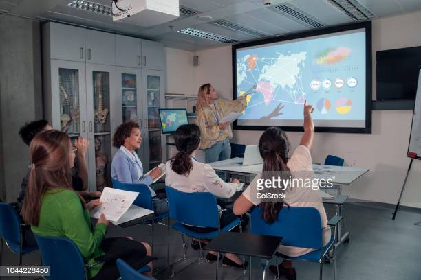 active presentation, classroom scenario, for university graduates.stem. - debate stock pictures, royalty-free photos & images