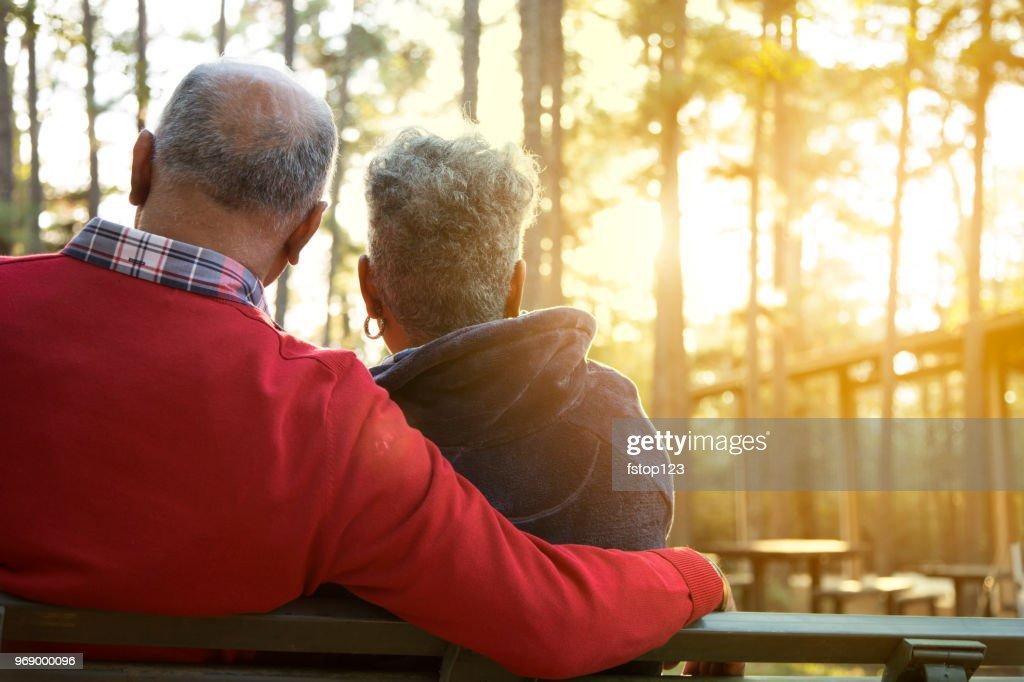 Active senior adult couple enjoy outdoor park at sunset. : Stock Photo