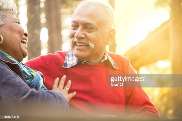 active senior adult couple enjoy outdoor park. - arab old man stock pictures, royalty-free photos & images