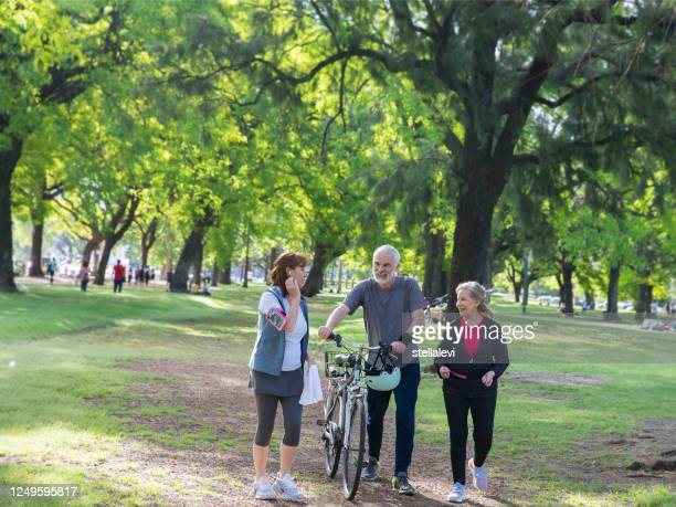 active senior adults exercising in the park - stellalevi stock pictures, royalty-free photos & images