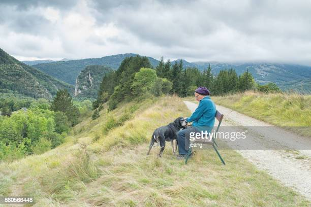 Active senior and dog in French mountains