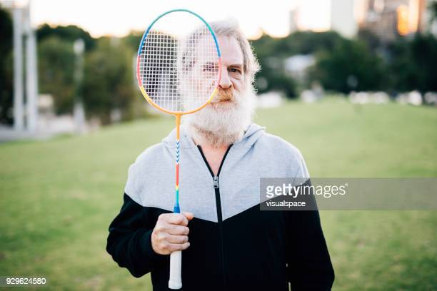 active senior badminton player in the sunset - badminton imagens e fotografias de stock