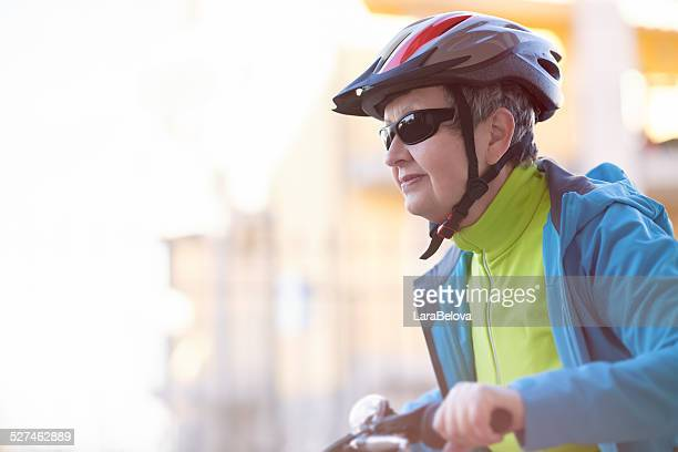 Active senior biking woman