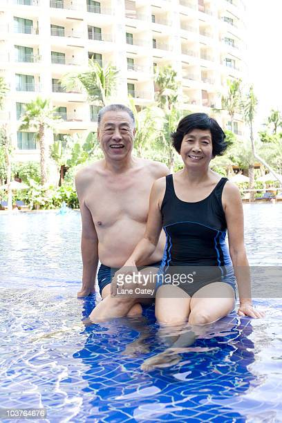 Active senior couple at the pool