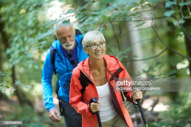 Active senior couple backpackers