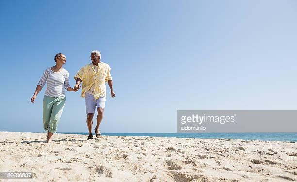 Active senior couple on the beach