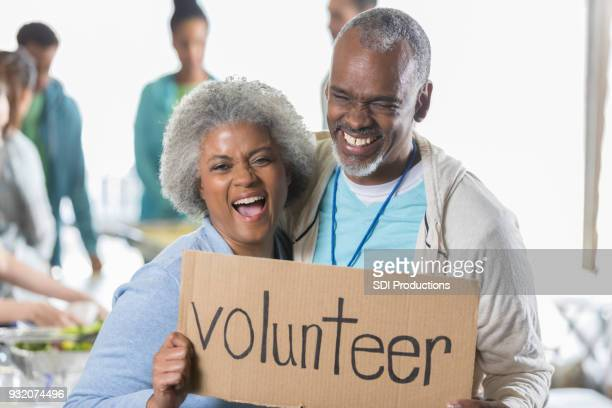 active senior couple volunteer during food drive - volunteer stock pictures, royalty-free photos & images