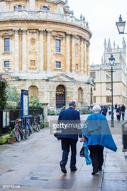 Active Senior Couple Walking on the Streets of Oxford, UK