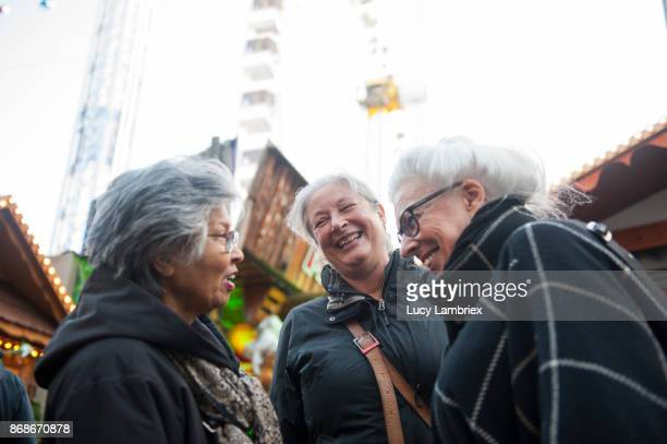 Active senior girlfriends enjoying themselves at the fair in Amsterdam