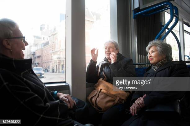Active senior girlfriends in the tram in Amsterdam