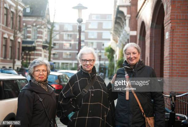 Active senior girlfriends on the street in Amsterdam