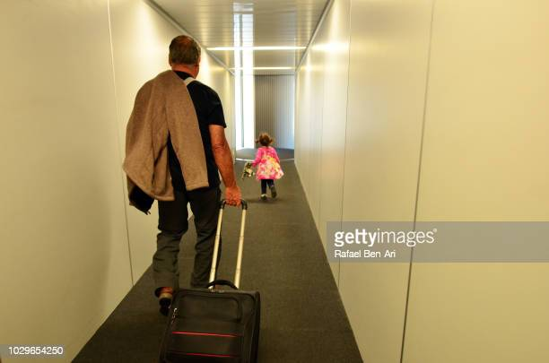 active senior in airport - passenger boarding bridge stock pictures, royalty-free photos & images