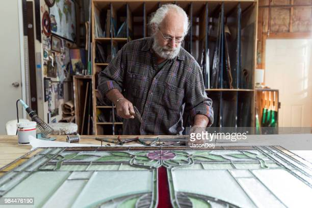 active senior in art studio - stained glass stock pictures, royalty-free photos & images