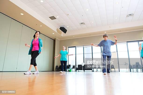 Active senior learn to dance at senior center