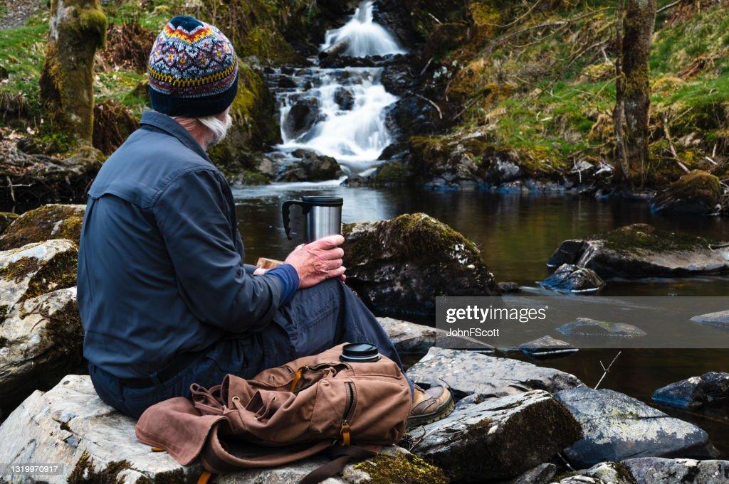 Active senior man taking a coffee break : Stock Photo