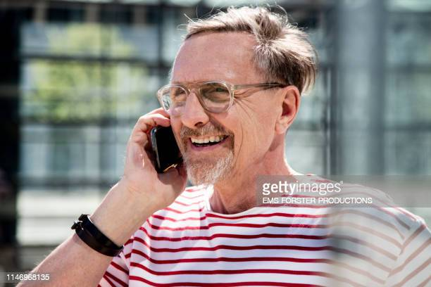 active Senior Man Talking an smiling  on cell phone