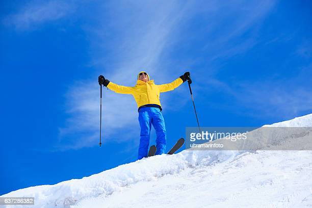 Active senior men snow skier  resting at the top