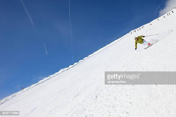 Active senior men snow skier skiing on sunny ski resorts