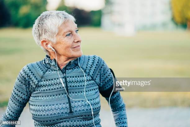 active senior sportswoman in the park - imperfection stock pictures, royalty-free photos & images