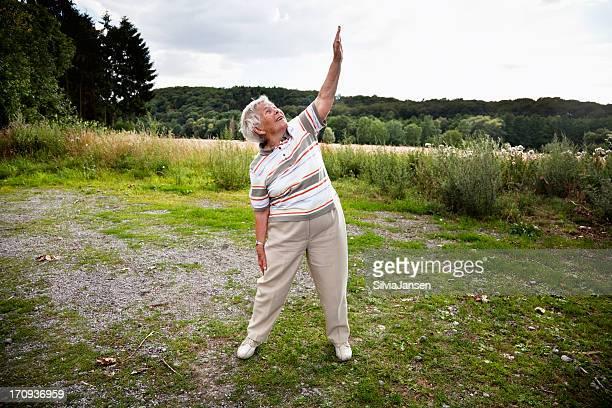 active senior woman doing yoga