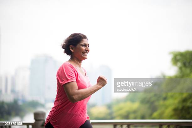 active senior woman enjoying a healthy lifestyle - indian subcontinent ethnicity stock pictures, royalty-free photos & images