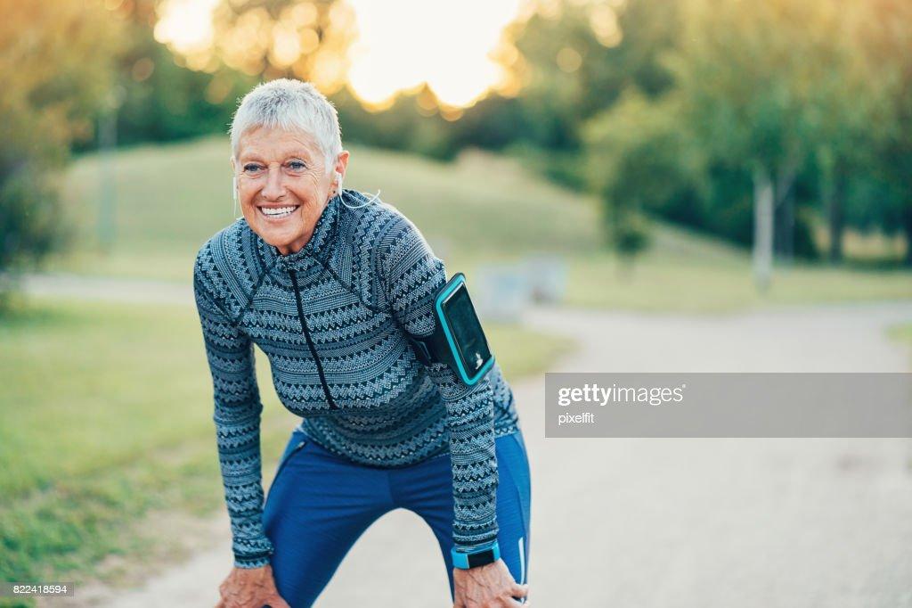 Active senior woman exercising outdoors : Stock Photo